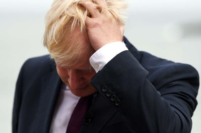 Boris Johnson reacts during a TV interview