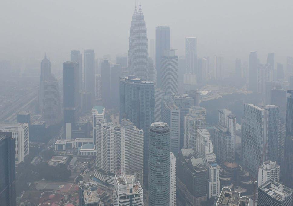 Burning haze blanketing cities sees hundreds of schools