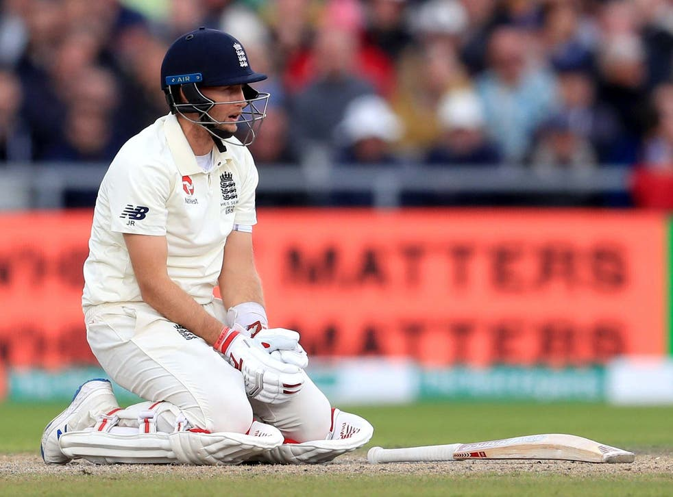 England's Joe Root goes down after being struck by the ball during day three of the fourth Ashes Test at Emirates Old Trafford on 6 September 2019