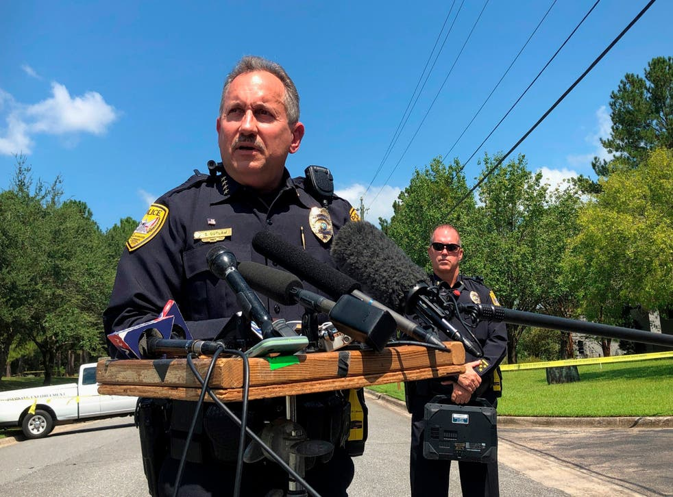Steven Outlaw, acting police chief in Tallahassee, Florida, briefs reporters over the stabbing of five people at a building supply company
