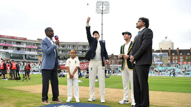 England Joe Root tosses the coin