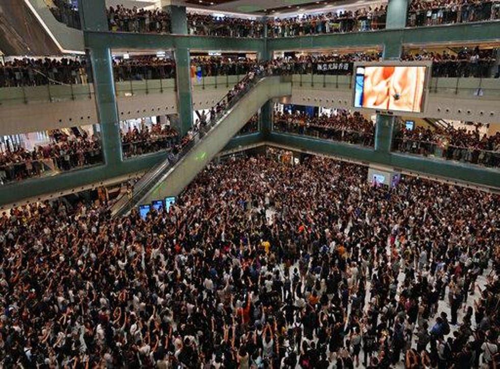 Hong Kong citizens sing protest karaoke at a city shopping mall