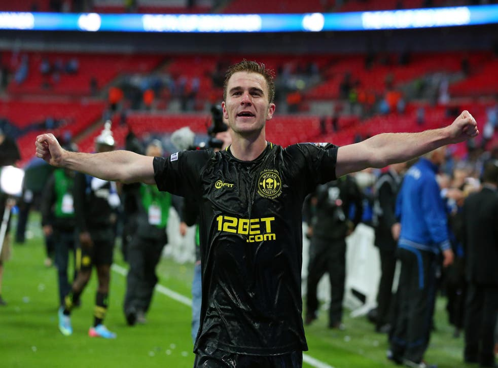 McManaman celebrates on the Wembley pitch after winning the FA Cup