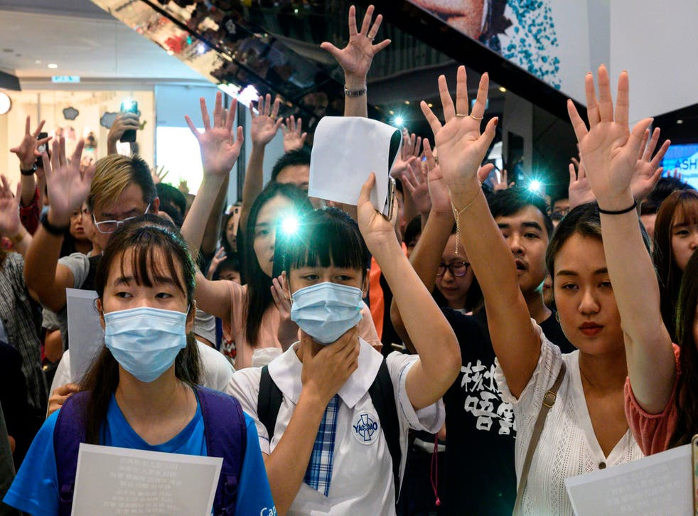 Pro-democracy demonstrators gather to sing songs and chant slogans during a rally at a shopping mall in Yuen Long