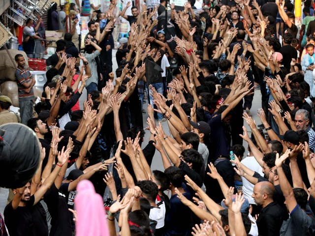 Indian Shiite Muslims mourn as they take part in a religious procession on the Ashura day - the 10th day of Muharram