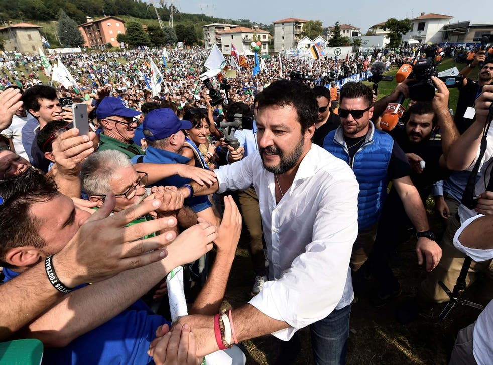 League party leader Matteo Salvini greets supporters during a packed rally in Pontida, Italy on 15 September