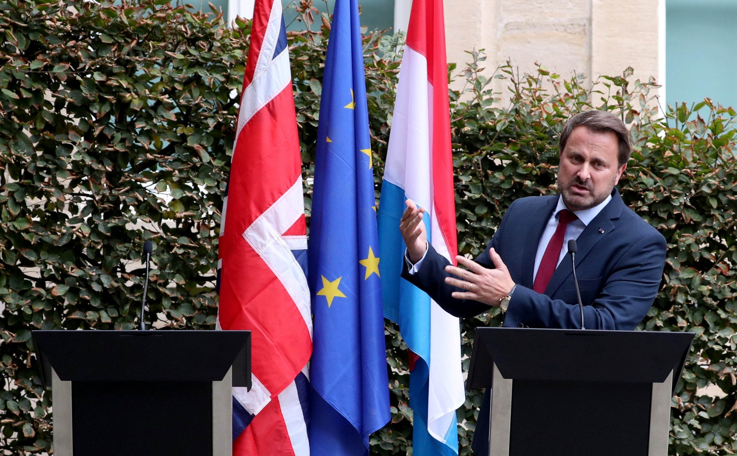 Boris Johnson 'chickens' out of own press conference amid noisy protests, leaving empty podium next to Luxembourg's PM