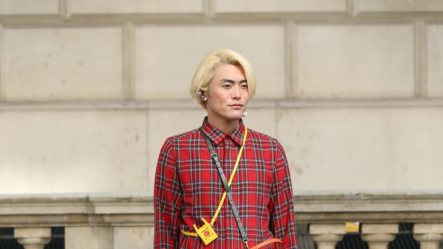 The popularity of plaid shows no signs of abating. This fashion week guest accessorised his bright scarlet ensemble with black loafers, camel-coloured socks and a tangerine shoulder bag.