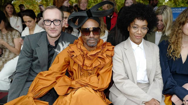 Billy Porter was quite literally the darling of London Fashion Week this season, making several front row appearances over the course of the event, attending each in a different ensemble. For Roksanda, he arrived in a spectacularly ruffly orange gown and a giant black bow on his head. Meanwhile, Ackie channeled a sophisticated librarian look in a loose-fitting taupe suit.
