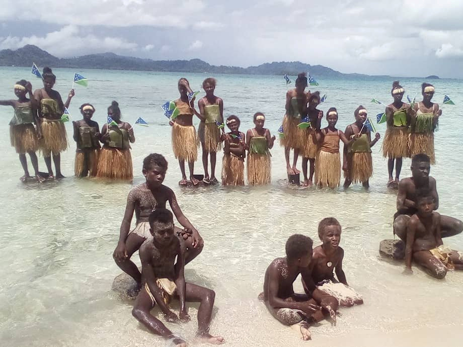 Students on islands vanishing beneath rising seas join global climate strike – by walking into ocean swallowing their homes