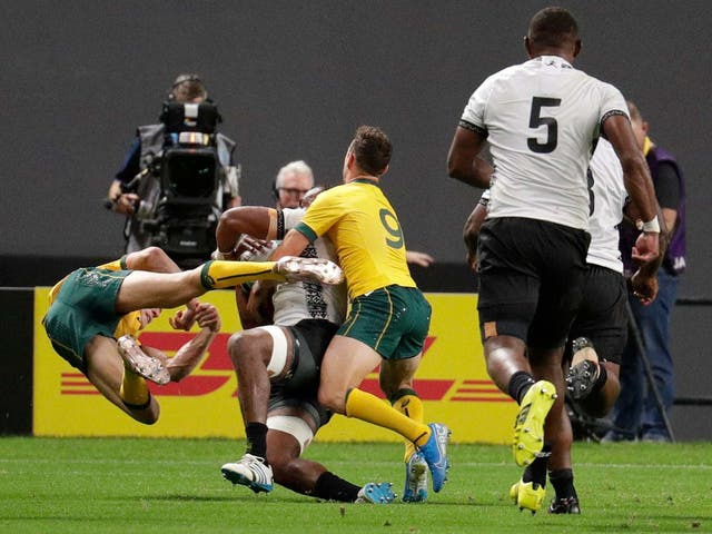 Reece Hodge (left) has been cited for this tackle on Peceli Yato during Australia's victory over Tonga