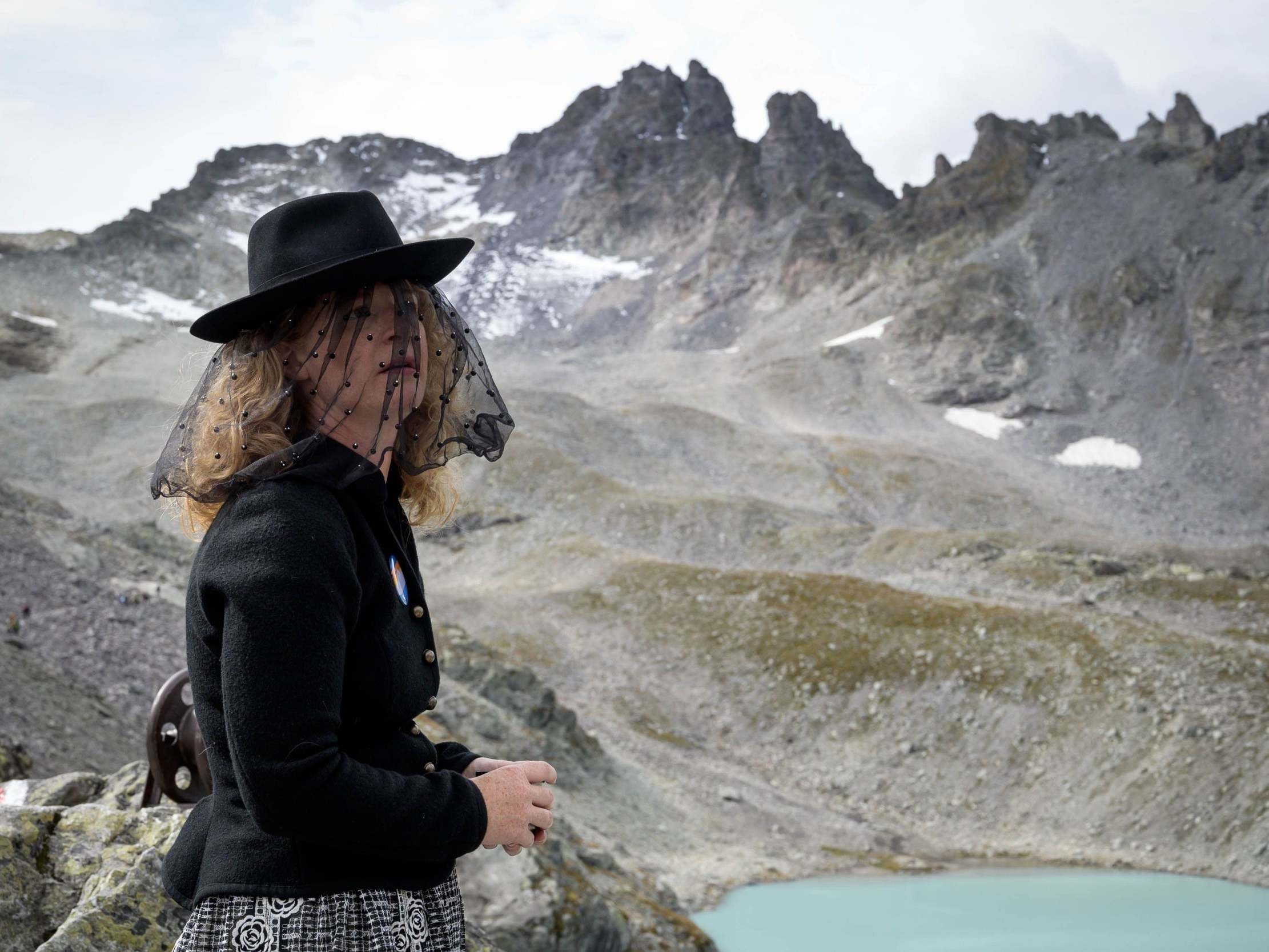 Hundreds of people hold 'funeral' for Swiss glacier lost to global w…