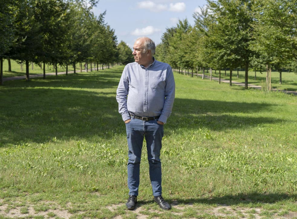 Head gardener Alain Baraton, between rows of trees at Versailles