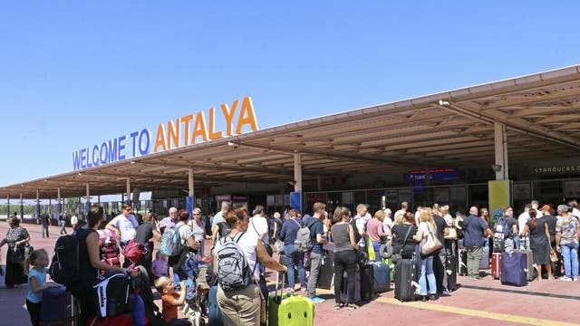 British passengers with Thomas Cook wait in long queue at Antalya airport in Turkey