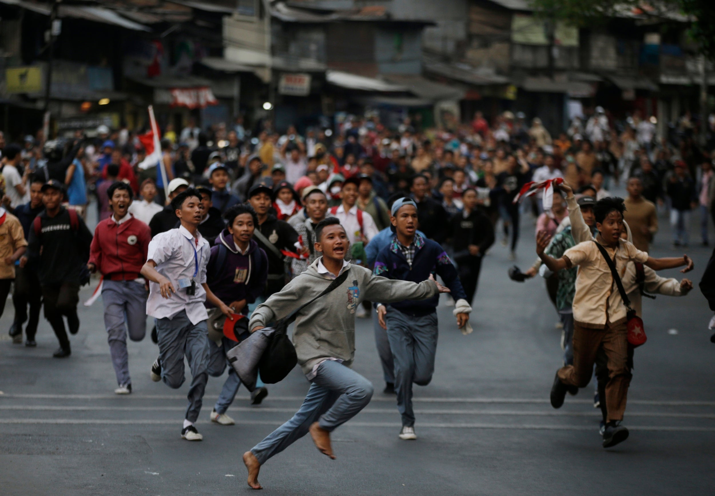 Indonesia protests: Police fire tear gas on third day of unrest over laws to ban sex outside marriage