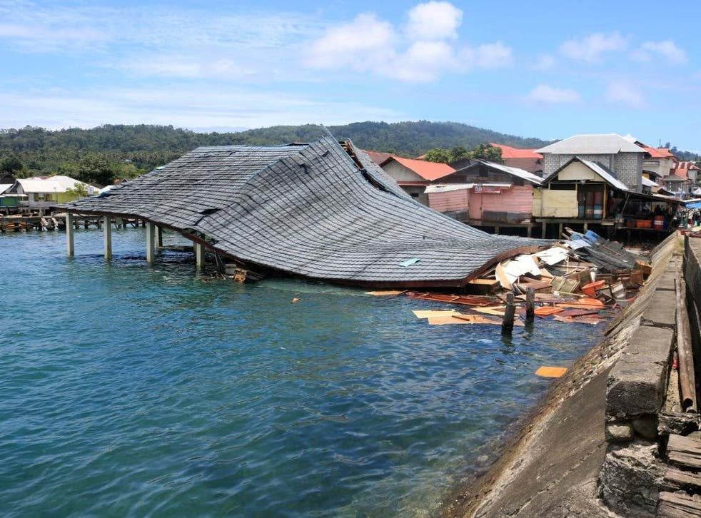 A damaged traditional market building is pictured following an earthquake in Ambon, Indonesia, on 26 September.