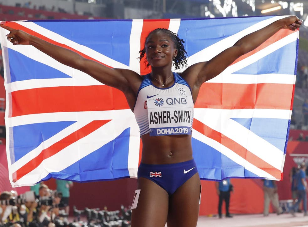 Dina Asher-Smith celebrates after setting a new personal best and British record