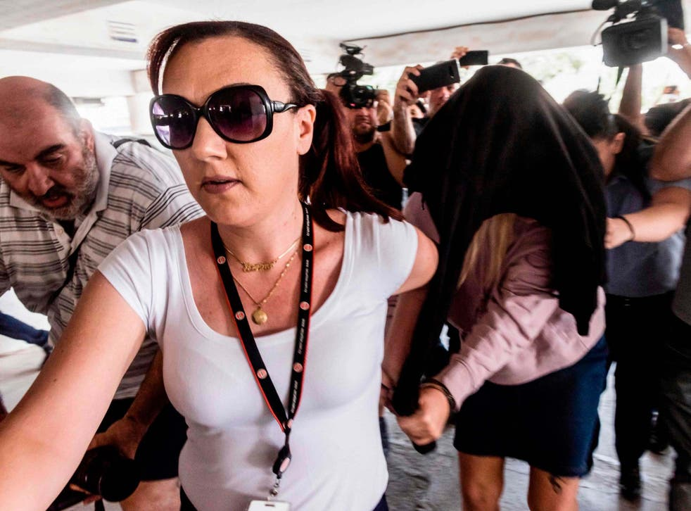 he 19-year-old woman, who claims she was gang-raped by 12 Israelis in the Cypriot party resort of Ayia Napa in July, has said she was forced into signing a confession withdrawing the criminal complaint