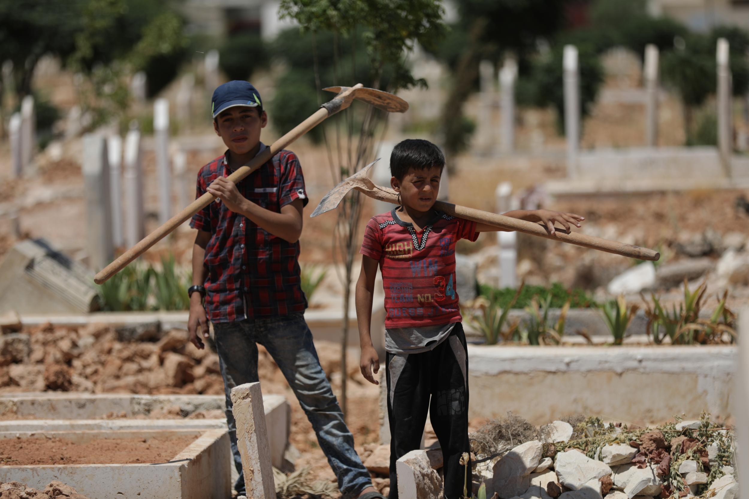 Children dig graves to survive in war-torn Idlib