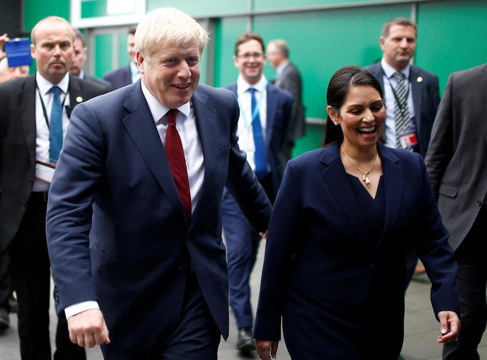 By this summer, climate change had risen to among the three most important issues facing this country. Pictured is Boris Johnson and Home Secretary Priti Patel