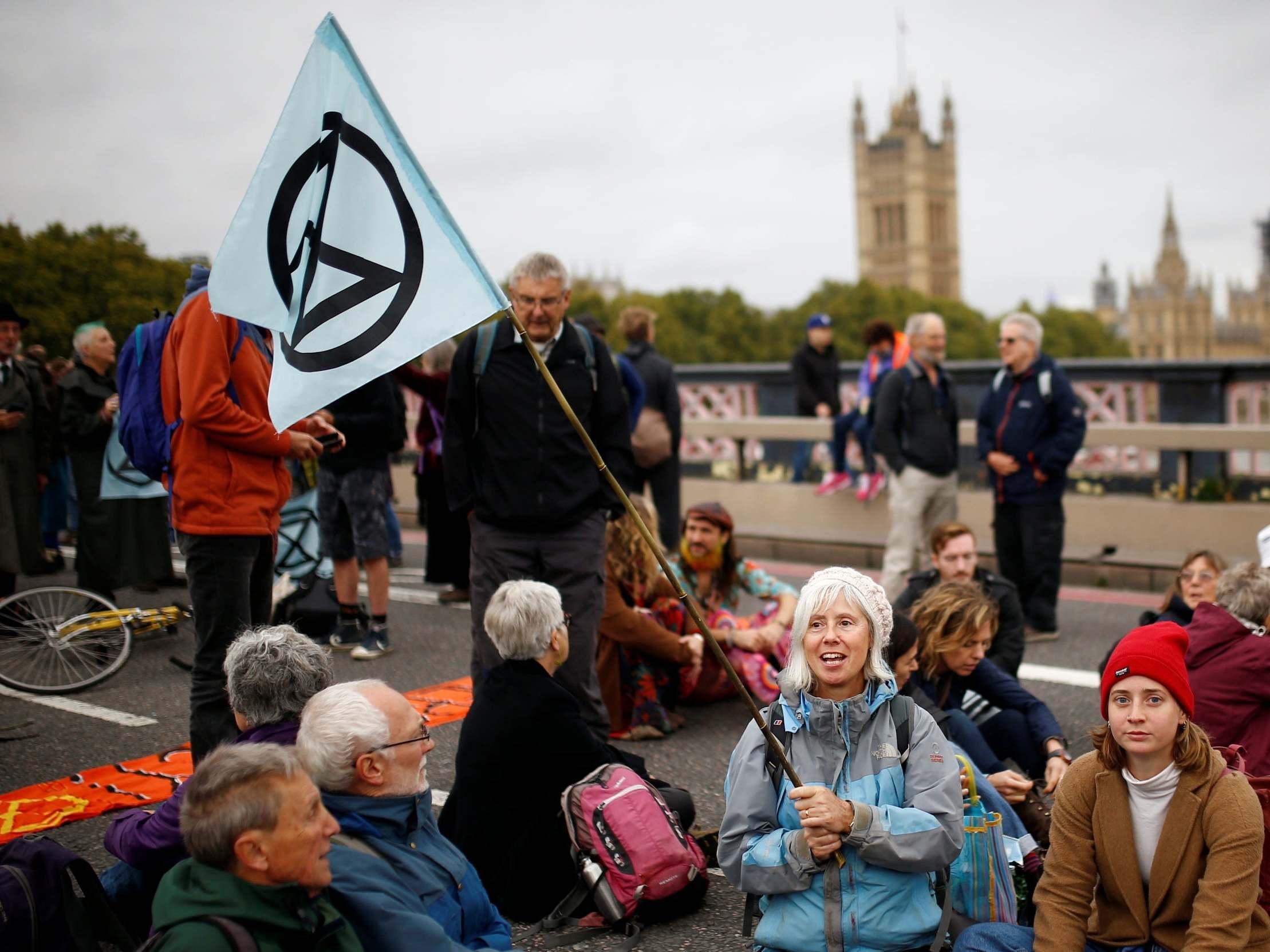 Extinction Rebellion protests - live: Climate activists shut down parts of central London as police arrest more than 200 demonstrators