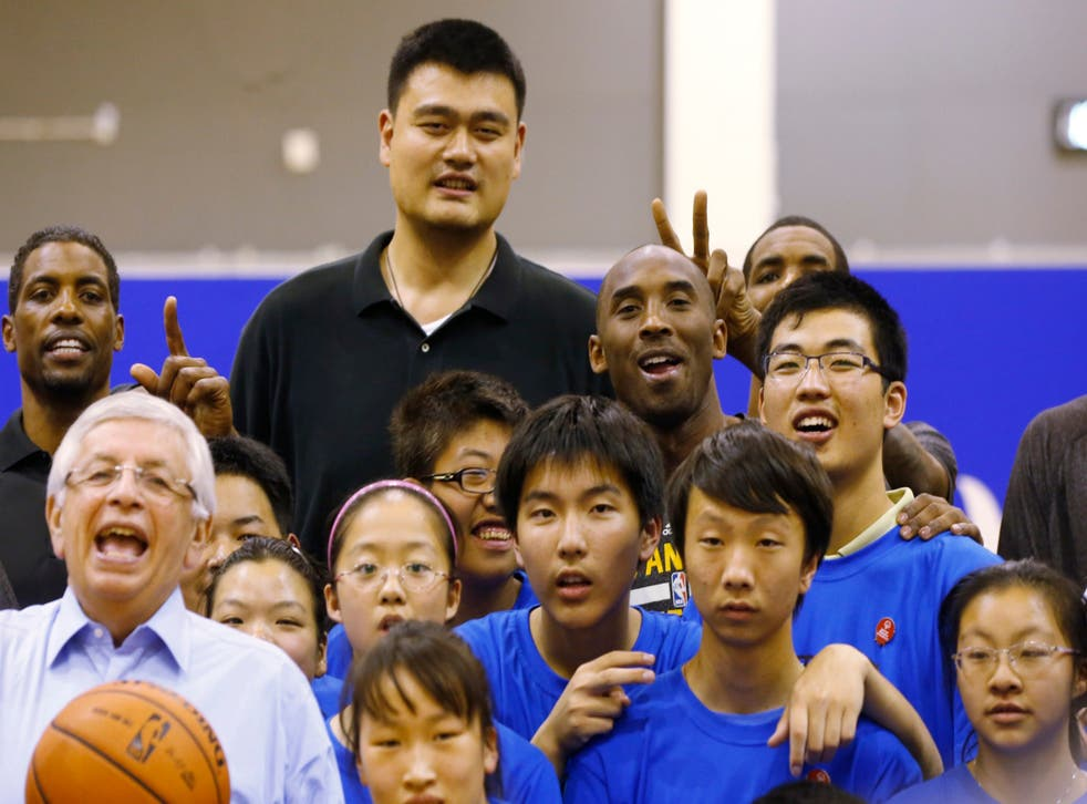 Former Rockets star and now Chinese Basketball Association president Yao Ming (top row centre) poses alongside Kobe Bryant during a 2013 event in Shanghai