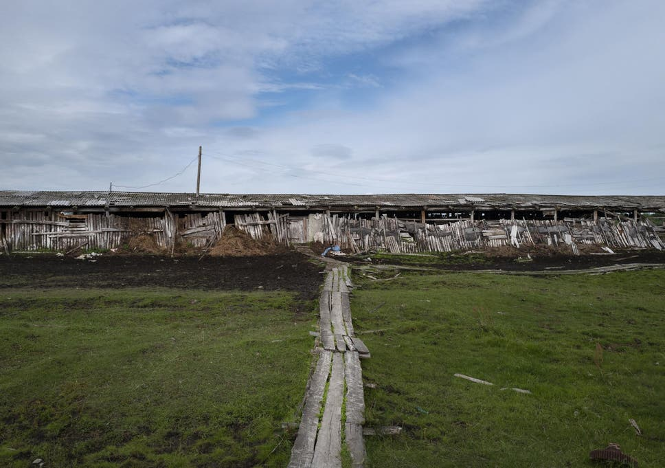 A building at a stockyard near Zyryanka illustrates the effects of the shifting ground