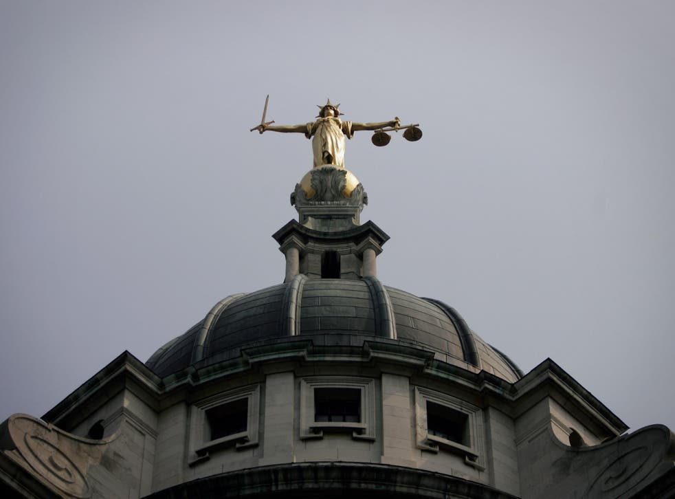 General view of the scales of justice on top of the Old Bailey, in London.