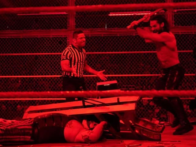 The match was stopped after Rollins used a sledgehammer