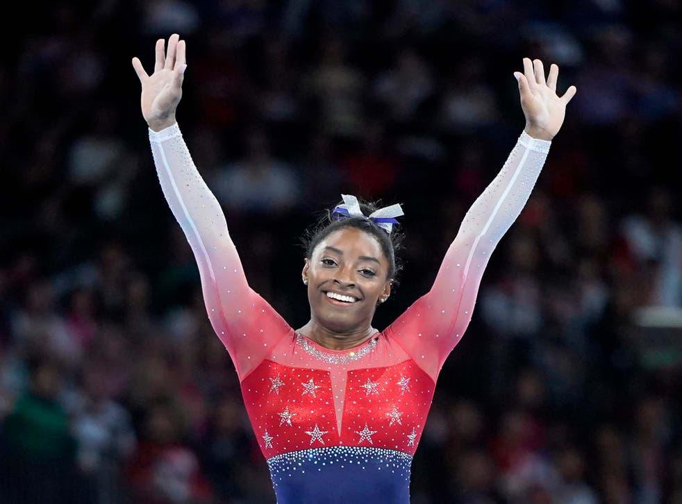 Simone Biles of USA celebrates after winning the women's team final