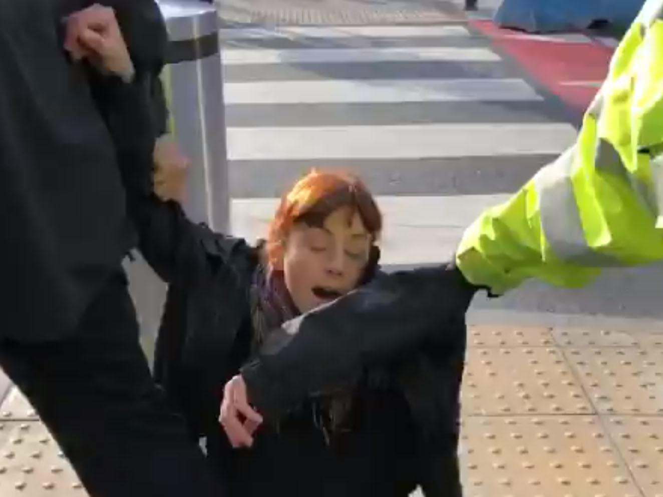 Extinction Rebellion protests - live: Police drag woman along ground as activist storms on to plane during 'Hong Kong-style' occupation of airport