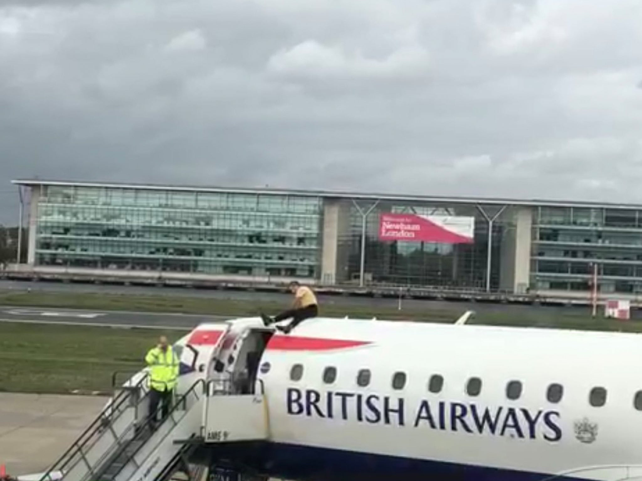 Extinction Rebellion protests: Man climbs on to British Airways plane before take-off as climate activists occupy airport