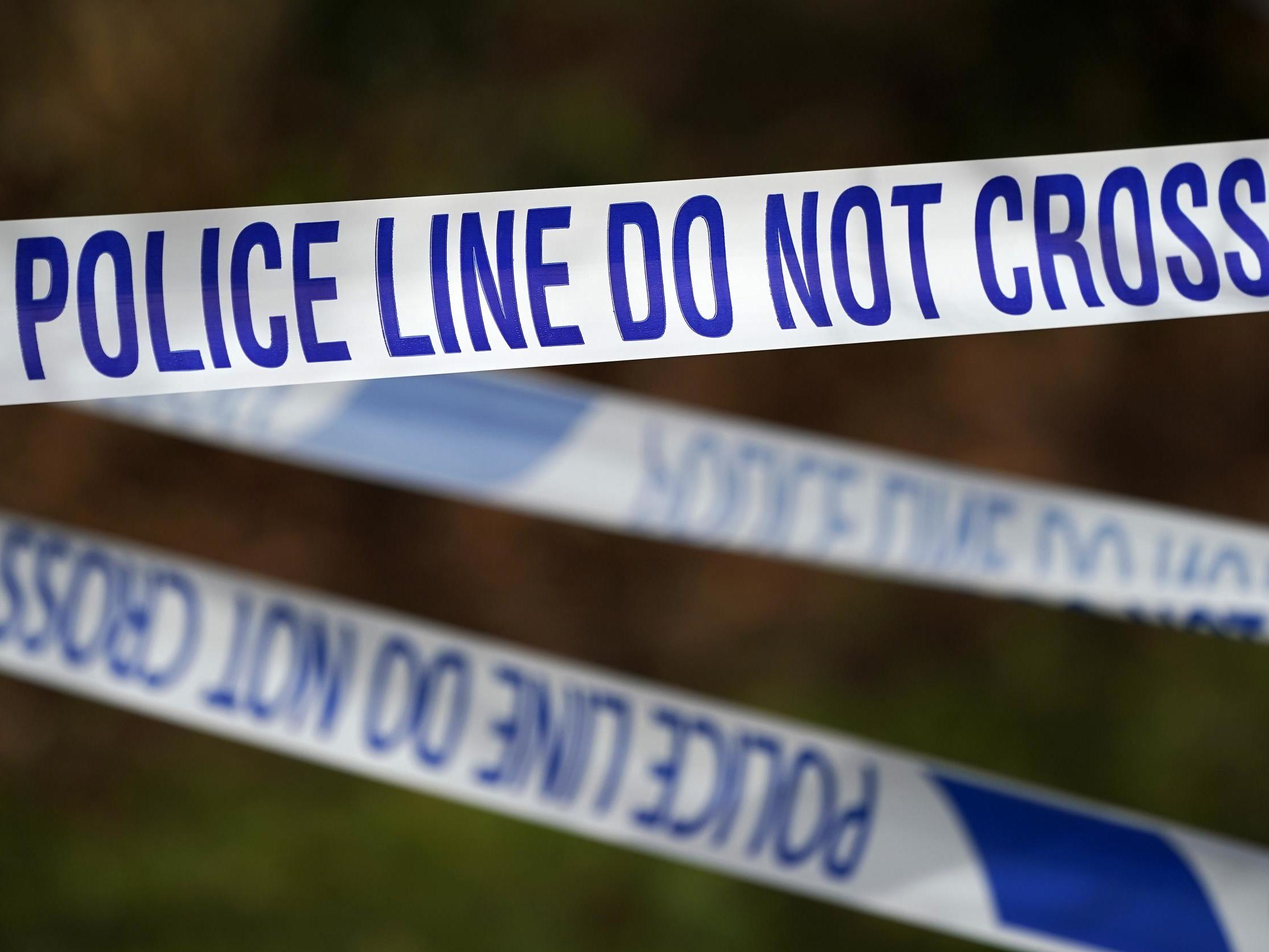 Man shot in 'paramilitary-style' attack while son was at home