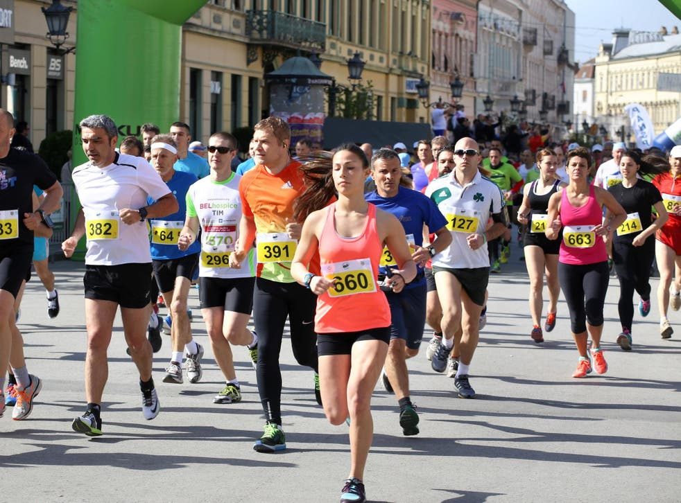 Stock image of runners during race.