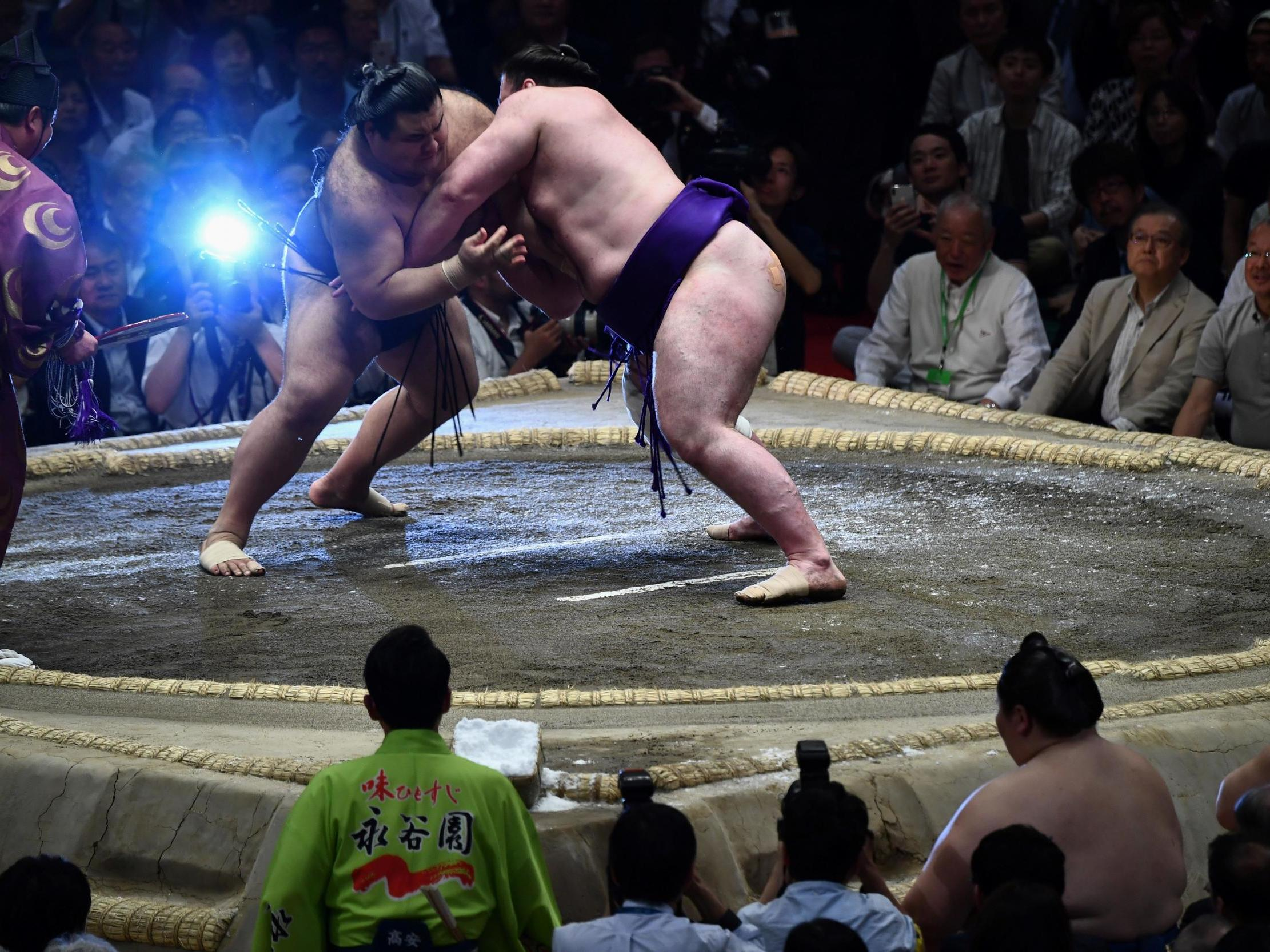 Violence, corruption and concussion: The dark side to sumo wrestling – and why its popularity endures