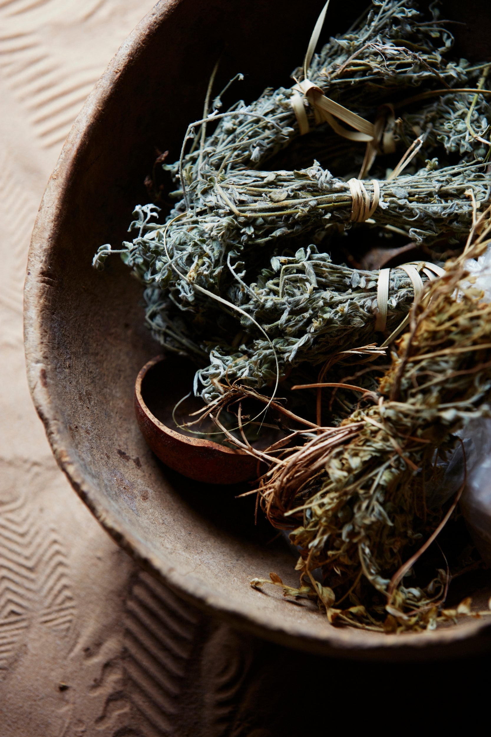 Herbs dry in the entrance to Aissa's home