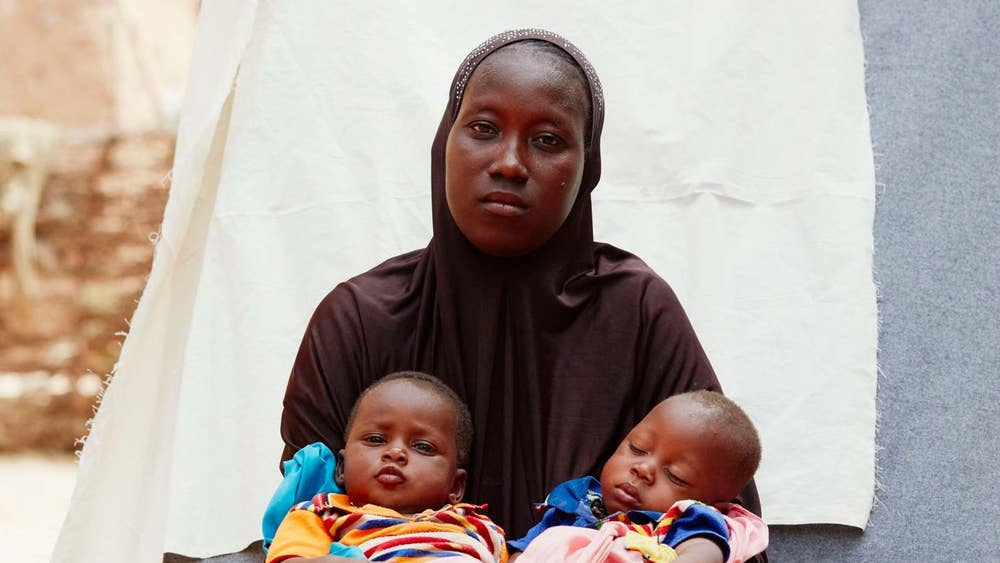 Balkisa Zakow, 25, with her twins Hassan and Ousseni, Tombokiery village, Niger