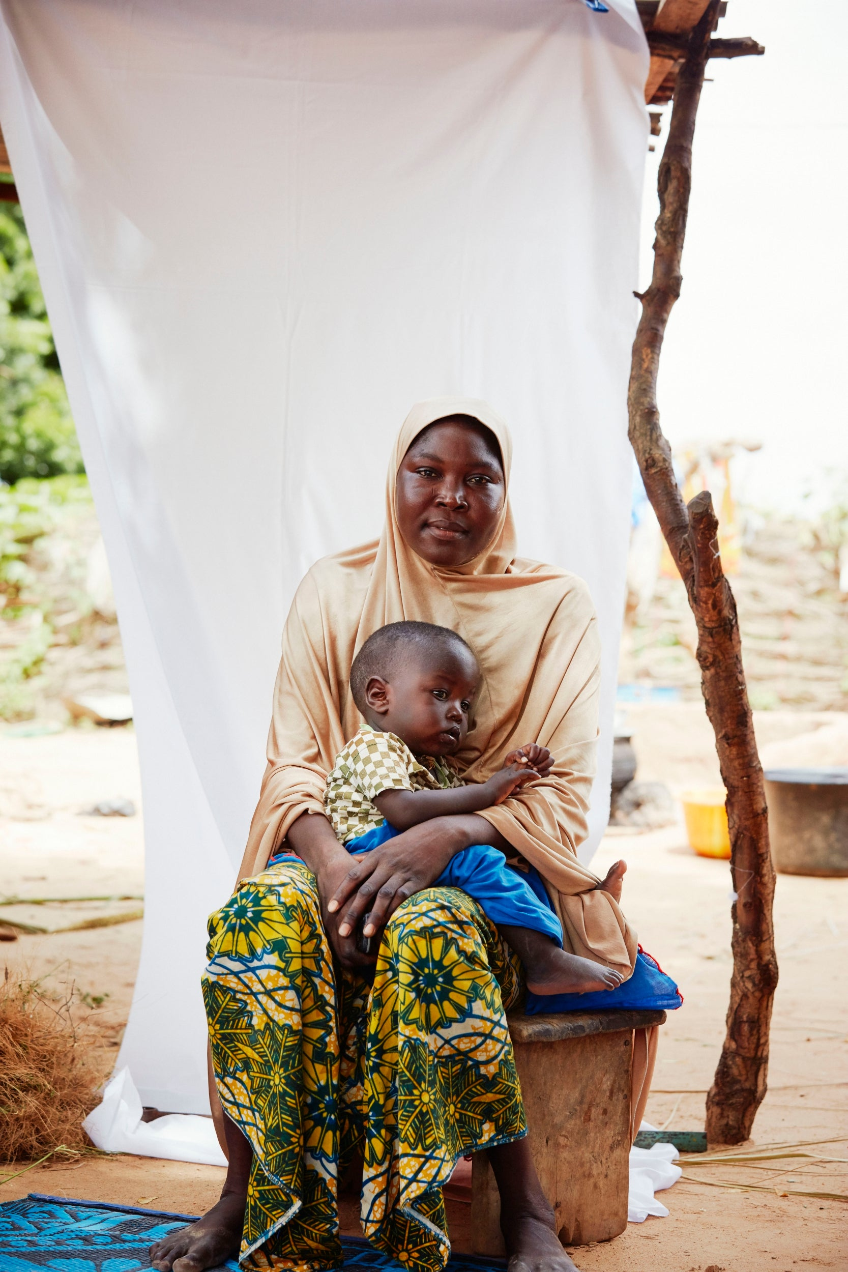 Hassi Seyni, 30, sits with her son, Mohamad Moufitaur, 15 months old – in Tombokiery village, southern Niger