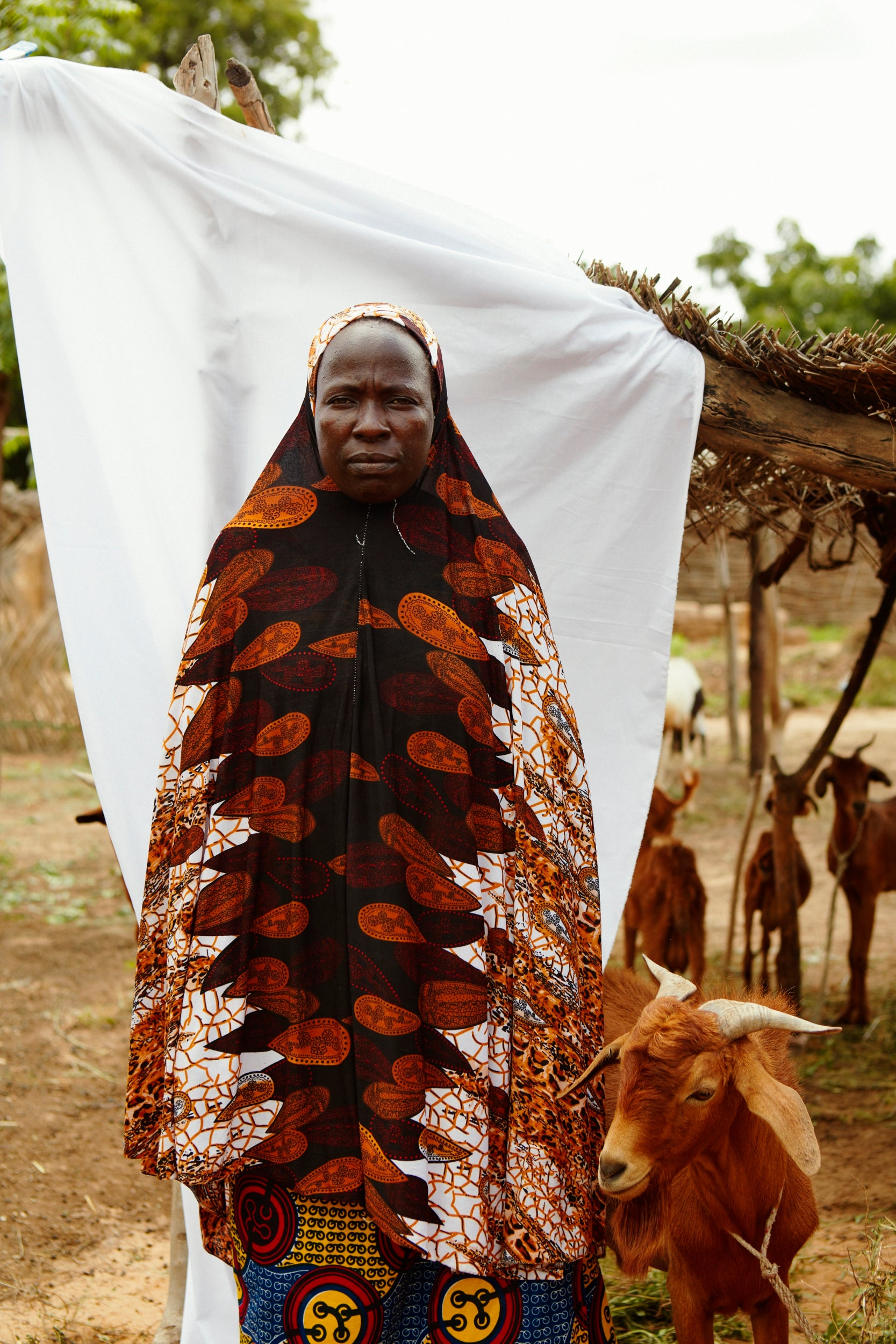 34-year-old Ouma Azzika with goat she was given from the Niger Red Cross