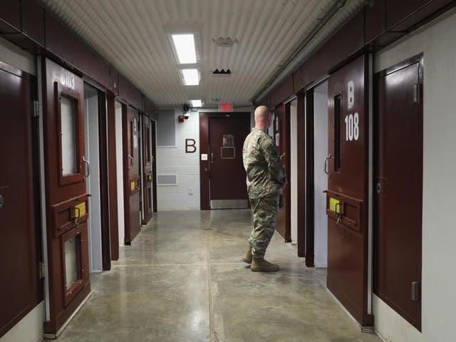 A US soldier patrols the notorious maximum security prison