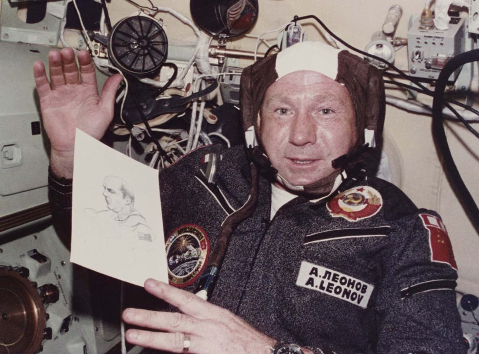 Leonov shows his drawing of Apollo commander Thomas P Stafford during a mission in July 1975