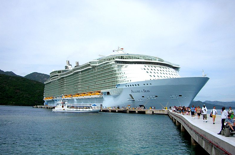 'Absolute idiot': Woman banned from Royal Caribbean cruises for life after hanging off ship's balcony for photoshoot
