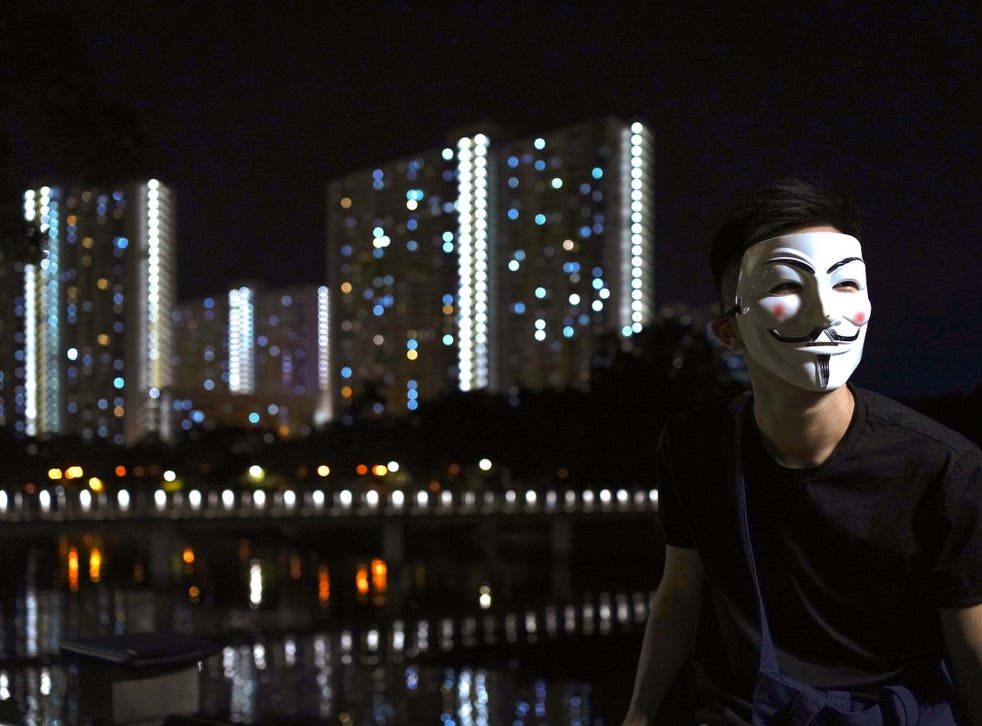 Pro-democracy protesters have been wearing black clothes and masks in Hong Kong (AP Photo/Vincent Wu)
