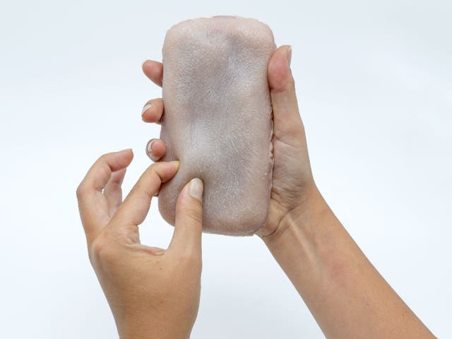 The prototype, which has been designed to look like and mimic human skin, responds to different forms of human contact