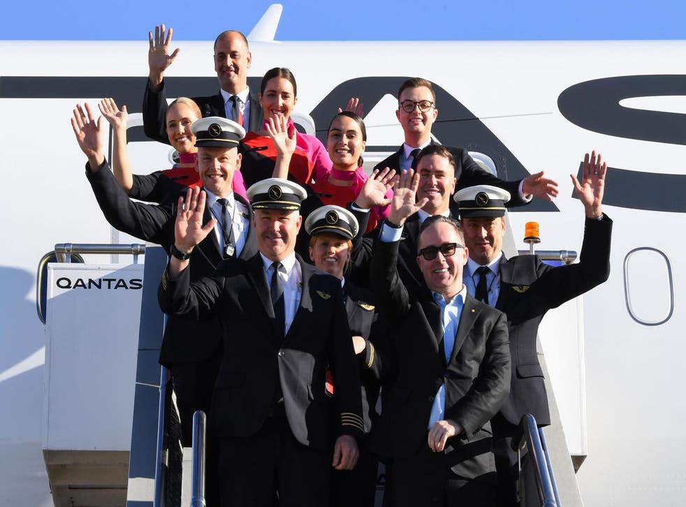 Bright start: the crew of Qantas flight QF7879 and the airline's chief executive on arrival at Sydney