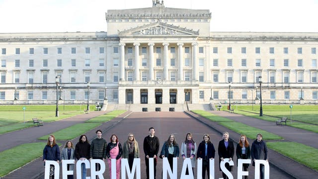 """Pro-choice campaigners stood outside the Stormont Estate on Monday 21 October with the word """"decriminalised"""" spelt out in front of them as some of Stormont's assembly members returned to the chamber for the first time in nearly three years. A group of Northern Irish lawmakers returned to parliament in a failed last-minute protest at the decriminalisation of abortion in the region."""
