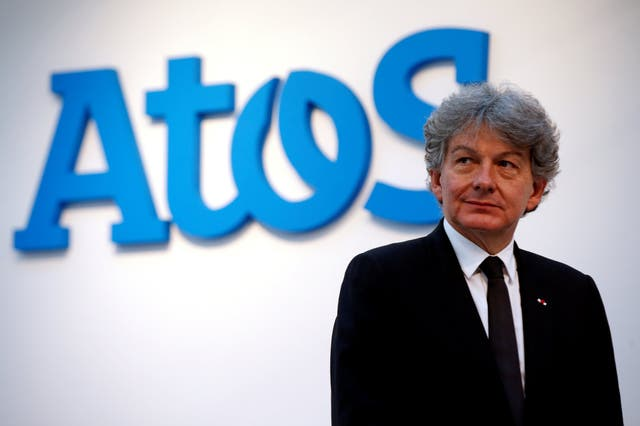 Atos Chairman and CEO Thierry Breton poses in front of the company's logo