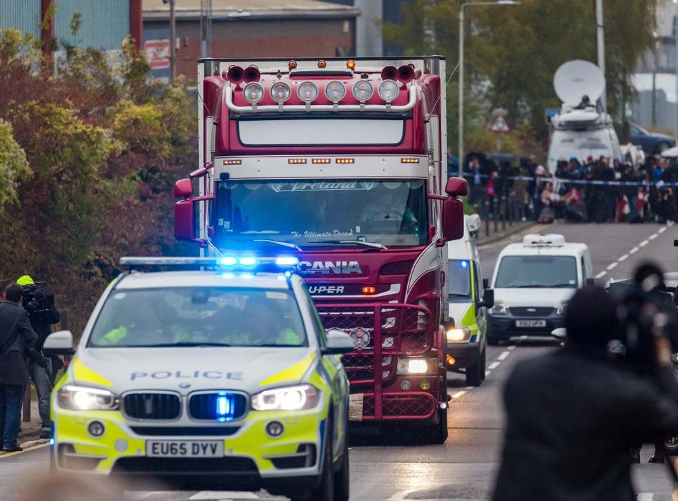 Police escort the lorry in which 39 bodies were discovered along the road from the scene in Waterglade Industrial Park, Grays, Essex