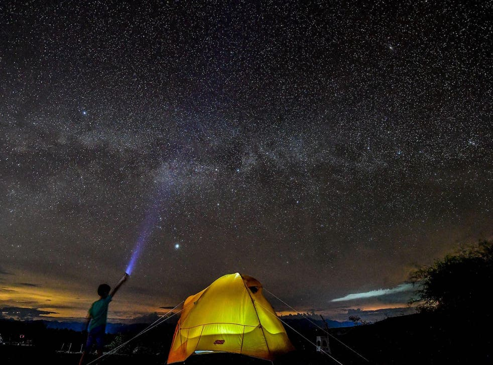 A boy watches the Milky Way in the sky over the Tatacoa Desert, in the department of Huila, Colombia, on October 11, 2018