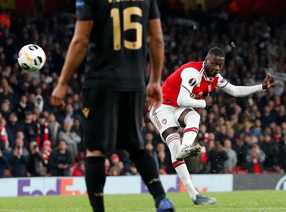 Nicolas Pepe bends in Arsenal's winning goal